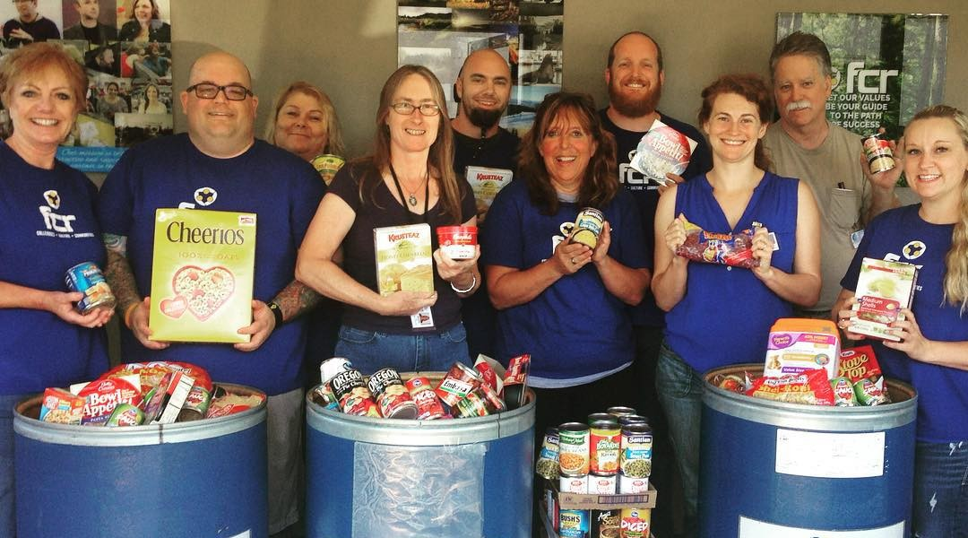 Members of FCR's Community Alliance Team and representatives of UCAN with food donations from the Roseburg call center.