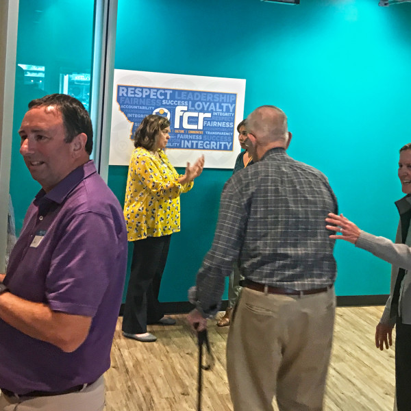 Community and business leaders at FCR's grand opening event with FCR President John Stadter (left), President Katheryn Carnahan (background), and Maureen Stadter (right).